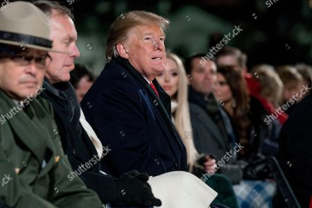 Donald Trump, Ryan Zinke. President Donald Trump attends the National Christmas Tree lighting ceremony at the Ellipse near the White House in Washington, . Also pictured is Interior Secretary Ryan Zinke, second from left