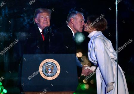 Interior Secretary Ryan Zinke greets first lady Melania Trump before President Donald Trump speaks during the National Christmas Tree Lighting ceremony on the Ellipse in Washington