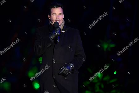 Stock Picture of Host Antonio Sabato, Jr. speaks during the annual National Christmas Tree Lighting ceremony on the Ellipse in Washington, . President Donald Trump and first lady Melania Trump attended for the lighting of the tree