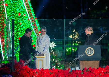 US President Donald Trump (R), First Lady Melania Trump (C) and host Antonio Sabato Jr. (L) participate in the 2018 National Christmas Tree Lighting at The Ellipse in President's Park south of the White House in Washington, DC, USA, 28 November 2018. This is the 96th annual lighting ceremony.