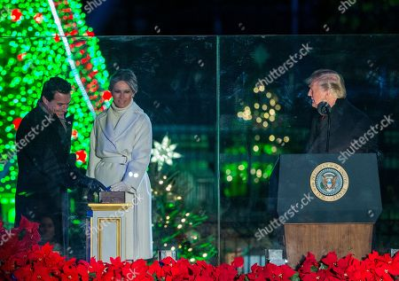 US President Donald J. Trump (R), First Lady Melania Trump (C) and host Antonio Sabato Jr. (L) participate in the 2018 National Christmas Tree Lighting at The Ellipse in PresidentÕs Park south of the White House in Washington, DC, USA, 28 November 2018. This is the 96th annual lighting ceremony.