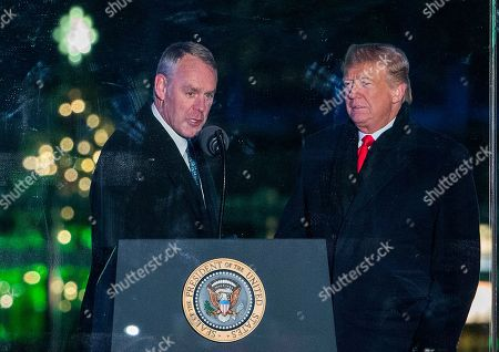 US President Donald Trump (R) and US Secretary of the Interior Ryan Zinke (L) participate in the 2018 National Christmas Tree Lighting at The Ellipse in President's Park south of the White House in Washington, DC, USA, 28 November 2018. This is the 96th annual lighting ceremony.