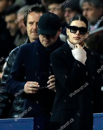 US actor Leonardo DiCaprio (L) and girlfriend Cami Morrone (R) in the stands during the UEFA Champions League Group C soccer match between Paris Saint Germain and Liverpool at the Parc des Princes stadium in Paris, France, 28 November 2018.
