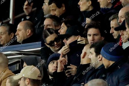 US actor Leonardo DiCaprio (C) and girlfriend Cami Morrone (L) in the stands during the UEFA Champions League Group C soccer match between Paris Saint Germain and Liverpool at the Parc des Princes stadium in Paris, France, 28 November 2018.