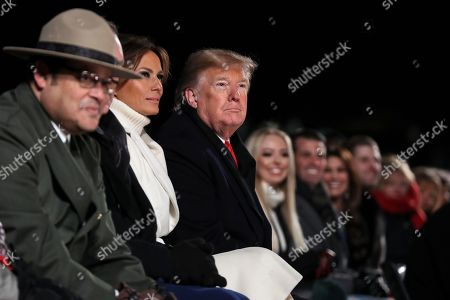 US President Donald Trump (3rd L), first lady Melania Trump (2nd L), Interior Secretary Ryan Zinke (hidden) and Director of the National Park Service David Vela (L), participate in the Lighting Ceremony during the 2018 National Christmas Tree Lighting Ceremony at the Ellipse near the White House in Washington, DC, USA, 28 November 2018. This is the 96th annual lighting ceremony.