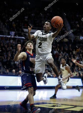 Purdue's Eric Hunter Jr. (2) puts up a shot against Robert Morris's Dante Treacy during the second half of an NCAA college basketball game, in West Lafayette, Ind. Purdue won 84-46