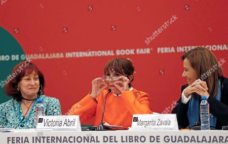 Stock Photo of Spanish actress Victoria Abril (C) along with British sociologist Catherine Hakim (L) and the former presidential candidate of Mexico Margarita Zavala (R) during the 'Me Too' forum as part of the International Book Fair (FIL) of Guadalajara, Jalisco, Mexico, 28 November 2018. The International Book Fair, is consider the biggest editorial event of the Hispanic world with the participation of 800 authors and 20,000 industry professionals. This year Portugal was the honor guest.