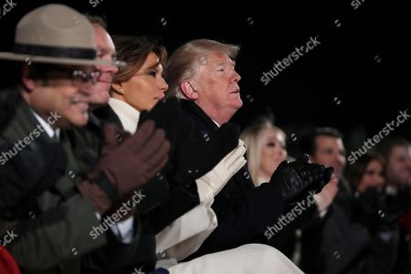 United States President Donald Trump and first lady Melania Trump Interior Secretary Ryan Zinke and Director of the National Park Service David Vela, left, participate in the Lighting Ceremony during the 2018 National Christmas Tree Lighting Ceremony at the Ellipse near the White House in Washington, DC.