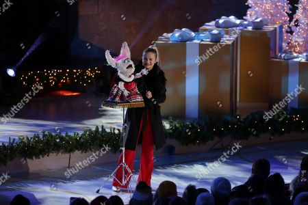 Darci Lynne Farmer performs onstage during the 86th annual Rockefeller Center Christmas Tree Lighting Ceremony, in New York