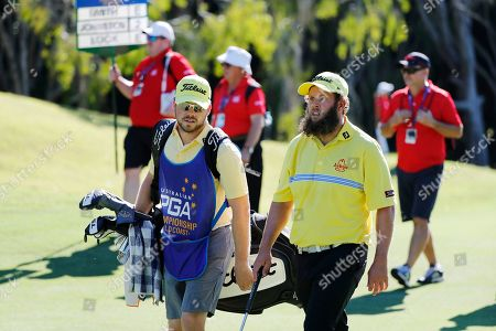Andrew Johnston (R) and his caddy on the fairway during play at the Pro-Am of the Australian PGA Championships at the Royal Pines Resort on the Gold Coast, Australia, 29 November 2018.