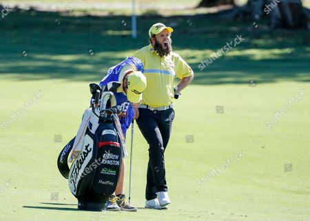 Andrew Johnston reacts while waiting to play his shot during play at the Pro-Am of the Australian PGA Championships at the Royal Pines Resort on the Gold Coast, Australia, 29 November 2018.