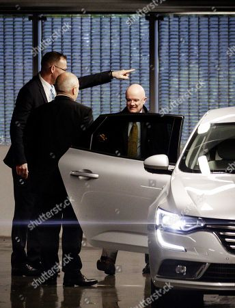 Stock Photo of Alliance executive vice president, Alliance Manufacturing Engineering John Martin (R) leaves the Renault Nissan Mitsubishi group car maker headquarters in Amsterdam, The Netherlands, 29 November 2018. The car manufacturers Renault, Nissan and Mitsubishi said in a joint statement that they would continue to work together. The Alliance's continued existence has been a big question mark since the arrest of Carlos Ghosn, the Alliance's leader.