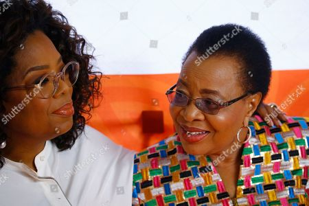 "Ms Oprah Winfrey (L) and Graca Machel (R) share a light moment as they arrive at the  Is'thunzi Sabafazi event held in Soweto, Johannesburg, South Africa, 29 October 2018.  The Nelson Mandela Foundation along with the Graça Machel Trust, Kuhluka Movement, and Zoleka Mandela Foundation hosted an event as part of the ""Remembrance period"" to mark five years since Madiba's passing and to recognize the 16 Days of Activism against Gender-based Violence."