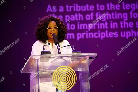 "Stock Picture of Ms Oprah Winfrey talks during the Is'thunzi Sabafazi event held in Soweto, Johannesburg, South Africa, 29 November 2018. The Nelson Mandela Foundation along with the Graça Machel Trust, Kuhluka Movement, and Zoleka Mandela Foundation hosted an event as part of the ""Remembrance period"" to mark five years since Madiba's passing and to recognize the 16 Days of Activism against Gender-based Violence."