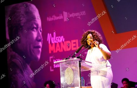 "Ms Oprah Winfrey talks during the Is'thunzi Sabafazi event held in Soweto, Johannesburg, South Africa, 29 November 2018. The Nelson Mandela Foundation along with the Graça Machel Trust, Kuhluka Movement, and Zoleka Mandela Foundation hosted an event as part of the ""Remembrance period"" to mark five years since Madiba's passing and to recognize the 16 Days of Activism against Gender-based Violence."