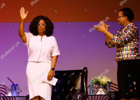 "Stock Photo of Ms Oprah Winfrey (L) and Mrs Graca Machel (R) during the  Is'thunzi Sabafazi event held in Soweto,, Johannesburg, South Africa, 29 November 2018. The Nelson Mandela Foundation along with the Graça Machel Trust, Kuhluka Movement, and Zoleka Mandela Foundation hosted an event as part of the ""Remembrance period"" to mark five years since Madiba's passing and to recognize the 16 Days of Activism against Gender-based Violence."