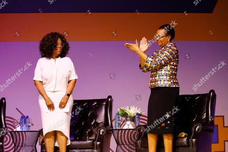"Stock Image of Ms Oprah Winfrey (L) and Mrs Graca Machel (R) during the  Is'thunzi Sabafazi event held in Soweto,, Johannesburg, South Africa, 29 November 2018. The Nelson Mandela Foundation along with the Graça Machel Trust, Kuhluka Movement, and Zoleka Mandela Foundation hosted an event as part of the ""Remembrance period"" to mark five years since Madiba's passing and to recognize the 16 Days of Activism against Gender-based Violence."