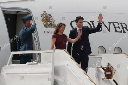 Canada's Prime Minister Justin Trudeau, right, and first lady Sophie Gregoire wave on their arrival to the Ministro Pistarini international airport for the G20 Summit in Buenos Aires, Argentina, . Leaders from the Group of 20 industrialized nations will meet in Buenos Aires for two-day starting Friday