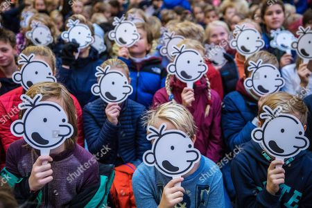 Children with the face of fictional character Greg Heffley during a gathering with the American cartoonist, producer and author of children's, Jeff Kinney, at the publishing house Gyldendal in Oslo, Norway, 29 November 2018.