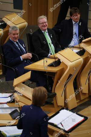 Scottish Parliament First Minister's Questions - Peter Chapman, Jackson Carlaw, Deputy Leader of the Scottish Conservative and Unionist Party and Alexander Burnett, listen to Nicola Sturgeon, First Minister of Scotland and Leader of the Scottish National Party (SNP)