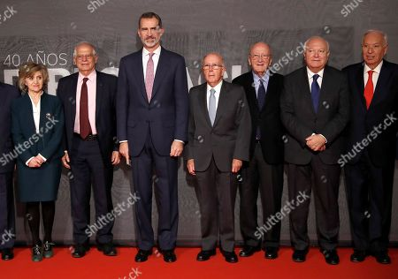 Stock Image of (L-R) Spanish Health Minister, Maria Luisa Carcedo; Spanish Foreign Minister, Josep Borrell; King Felipe VI of Spain and former foreign ministers Marcelino Oreja, Carlos Westendorp, Miguel Angel Moratinos and Jose Manuel Garcia-Margallo pose for a family picture during the opening of the exhibition '40 Years of Diplomacy in Democracy' in Casa America in Madrid, Spain, 29 November 2018.
