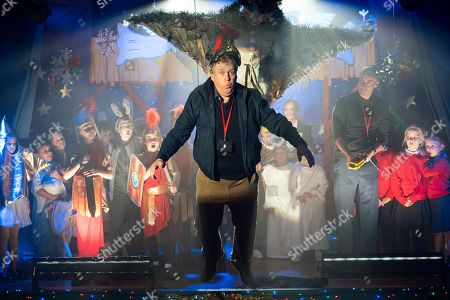 Ep 9642 Wednesday 19th December 2018 - 1st Ep When Brian Packham, as played by Peter Gunn, is sent home during the nativity final run through by Phil, as played by Tom Turner, for exhaustion, he drowns his sorrows in the Rovers but he decides he has every right to watch the show so drunkenly sneaks in to the back of the hall with Cathy. David, Shona, Mary, Maria, Kevin and Tyrone are also in the audience while Phil paints himself a hero to the governors. When Jack spots Brian he, Liam and the others revert to the rap version of the play which is a resounding success. Jealous Phil calls Brian up on stage but as Brian takes a bow, Phil hitches his belt to the Angel Gabriel's harness and hoists him in the air.