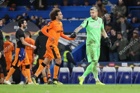 Amr Warda of PAOK FC (74) and Alexandros Paschalakis of PAOK FC (31) slapping hands during the Champions League group stage match between Chelsea and PAOK Salonica at Stamford Bridge, London