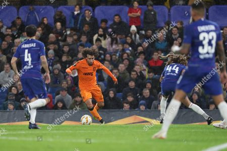 Amr Warda of PAOK FC (74) taking on Ethan Amoadu of Chelsea (44) during the Champions League group stage match between Chelsea and PAOK Salonica at Stamford Bridge, London
