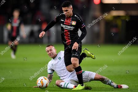 Leverkusen's Paulinho (R) in action against Ludogorets' Jacek Goralski (L) during the UEFA Europa League Group A soccer match between Bayer Leverkusen and PFC Ludogorets Razgrad at BayArena in Leverkusen, Germany, 29 November 2018.
