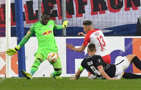 Leipzig goalkeeper Yvon Mvogo makes a save next to Salzburg's Hannes Wolf during the Europa League, Group B, soccer match between FC Salzburg and RB Leipzig on the Station Salzburg, in Salzburg, Austria