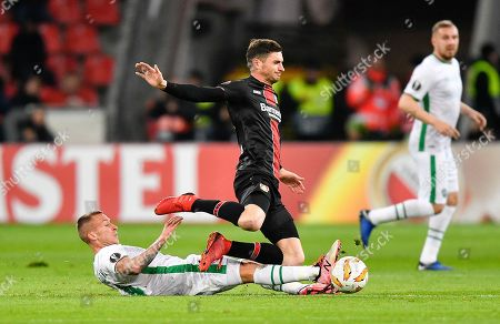 Ludogorets' Jacek Goralski, left, and Leverkusen's Lucas Nicolas Alario challenge for the ball during the Europa League Group A soccer match between Bayer 04 Leverkusen and PFC Ludogorets in Leverkusen, Germany