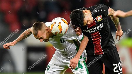 Ludogorets' Jacek Goralski, left, and Leverkusen's Charles Aranguiz challenge for the ball during the Europa League Group A soccer match between Bayer 04 Leverkusen and PFC Ludogorets in Leverkusen, Germany