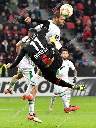 Ludogorets' Georgi Terziev, up, and Leverkusen's Isaac Kiese Thelin challenge for the ball during the Europa League Group A soccer match between Bayer 04 Leverkusen and PFC Ludogorets in Leverkusen, Germany