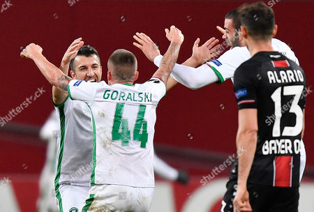 Ludogorets' Jacek Goralski celebrates with teammates during the Europa League Group A soccer match between Bayer 04 Leverkusen and PFC Ludogorets in Leverkusen, Germany