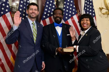 Paul Ryan, Brenda Jones, John Pitts. House Speaker Paul Ryan of Wis., left, poses for a photo during a ceremonial swearing-in of Rep.-elect Brenda Jones, D-Mich., right, as John Pitts, center, holds the Bible on Capitol Hill in Washington