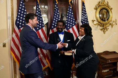 Paul Ryan, Brenda Jones, John Pitts. House Speaker Paul Ryan of Wis., left, reaches out to shake hands with Rep.-elect Brenda Jones, D-Mich., before a ceremonial swearing-in on Capitol Hill in Washington, . John Pitts, center, holds the Bible