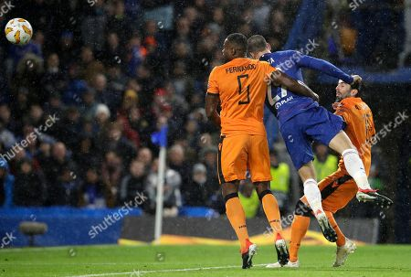 Chelsea's Alvaro Morata, right, heads the ball away from PAOK's Fernando Varela to score his team's fourth goal during the Europa League Group L soccer match between Chelsea and PAOK at Stamford Bridge stadium, in London