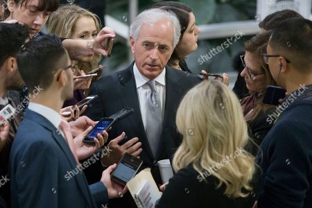 Republican Senator from Tennessee and Chairman of the Senate Foreign Relations Committee Bob Corker (C) speaks to members of the news media near the Senate subway before a Senate vote on Capitol Hill in Washington, DC, USA, 29 November 2018.