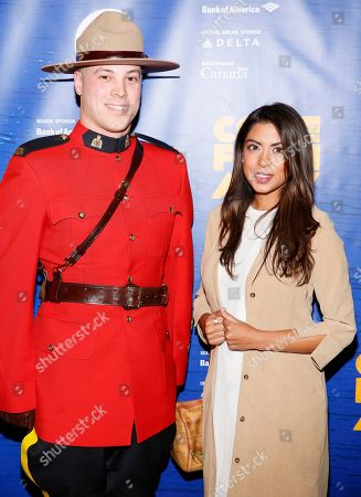A member of the Royal Canadian Mounted Police and Aliya Jasmine Sovani
