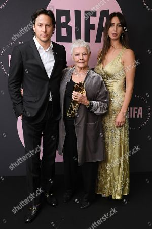 Stock Photo of Judi Dench - The Richard Harris Award for Outstanding Contribution by an Actor to British Film, presented by Cary Fukunaga and Ella Harris