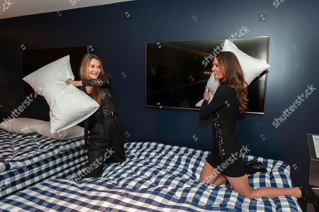 Gyunel Boateng, Kim Johnson. Model Gyunel Boateng, left, and designer Kim Johnson attend a bed manufacturers launch in London