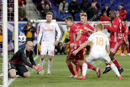 A shot by New York Red Bulls defender Tim Parker, third from right, gets by Atlanta United goalkeeper Brad Guzan, left, for a goal during the second half of the second leg of the MLS soccer Eastern Conference championship, in Harrison, N.J. The Red Bulls won 1-0, but Atlanta United won on aggregate