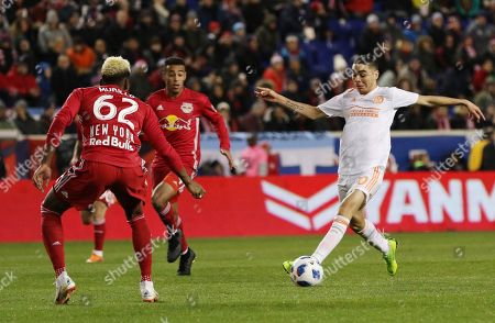 Atlanta United midfielder Miguel Almiron, right, moves the ball as New York Red Bulls defender Michael Amir Murillo, left, defends during the second leg of an MLS Eastern Conference Championship soccer match, in Harrison, N.J. Atlanta United won 3-1 on aggregate