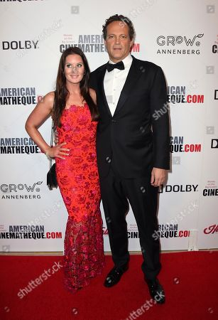 Stock Picture of Vince Vaughn, Kyla Weber. Vince Vaughn, right, and Kyla Weber arrive at the American Cinematheque Award ceremony honoring Bradley Cooper, at the Beverly Hilton Hotel in Beverly Hills, Calif