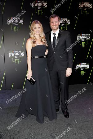 Amy Reimann, left, and Dale Earnhardt Jr. arrive at the NASCAR auto racing awards ceremony, in Las Vegas