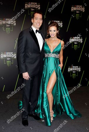 Kyle Busch, left, and Samantha Busch arrive at the NASCAR auto racing awards ceremony, in Las Vegas