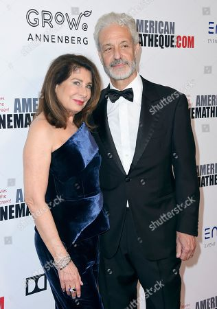 Paula Wagner, Rick Nicita. Paula Wagner, left, and Rick Nicita arrive at the American Cinematheque Award ceremony honoring Bradley Cooper, at the Beverly Hilton Hotel in Beverly Hills, Calif
