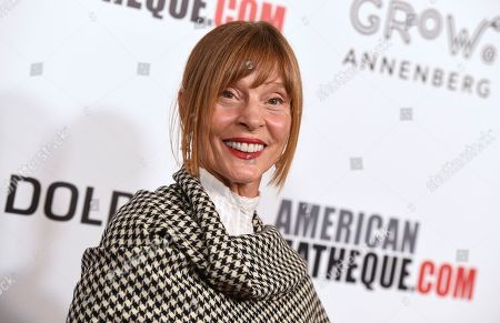 Stock Photo of Leigh Taylor-Young arrives at the American Cinematheque Award ceremony honoring Bradley Cooper, at the Beverly Hilton Hotel in Beverly Hills, Calif