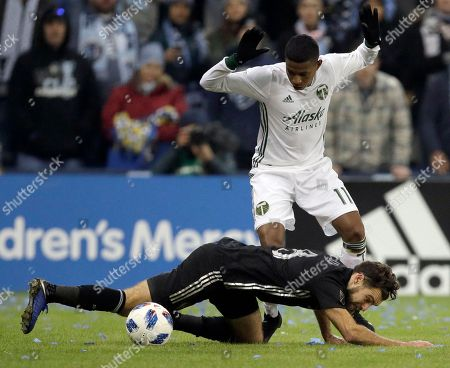 Graham Zusi, Andy Polo. Sporting Kansas City midfielder Graham Zusi (8) and Portland Timbers forward Andy Polo (11) compete for the ball during the first half in the second leg of the MLS soccer Western Conference championship in Kansas City, Kan