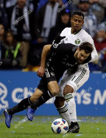 Graham Zusi, Andy Polo. Sporting Kansas City midfielder Graham Zusi, front, tries to get around Portland Timbers forward Andy Polo (11) during the first half in the second leg of the MLS soccer Western Conference championship in Kansas City, Kan